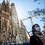 photo: A lone tourist in Barcelona, one of several global cities that have seen a massive crash in Airbnb bookings.