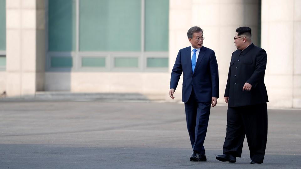 Kim Jong Un and Moon Jae In walking