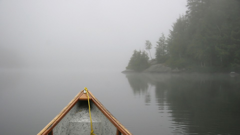 A canoe on foggy Lake Ontario
