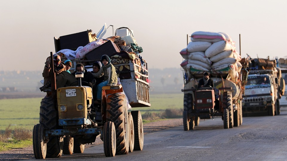 Convoys of displaced Syrians leave Idlib in January.