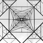 A black-and-white image of a transmission tower photographed from underneath