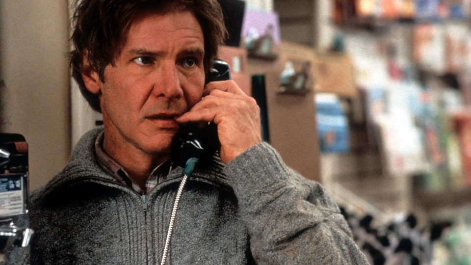 Harrison Ford on a payphone in a scene from the film 'The Fugitive'