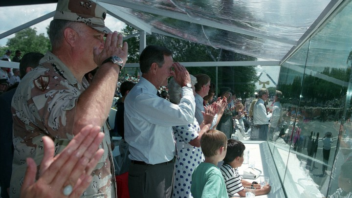 General Norman Schwarzkopf and President George H.W. Bush salute troops at the victory parade in Washington on June 8, 1991.
