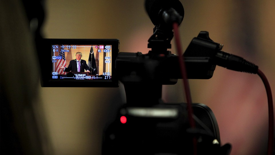 The president being filmed through a video camera
