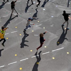 Students playing outside of reopened schools in Paris, France on May 14, 2020.