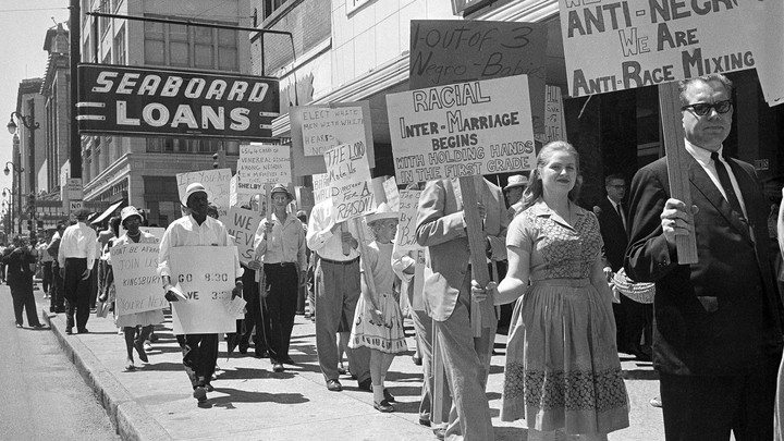 A group of black marchers protesting school-board policies is met by white counterprotesters during a double demonstration in Memphis on August 31, 1963.