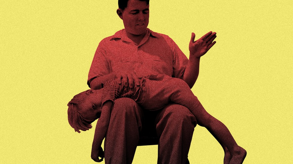 A child laid over the lap of an adult preparing to spank him