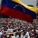 Demonstrators march during an opposition rally in Caracas, Venezuela.