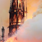a photo of Notre Dame cathedral burning