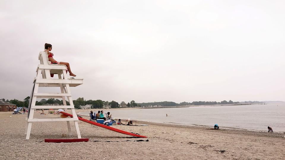 A female lifeguard overlooks the ocean