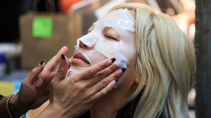 A model wears a face mask