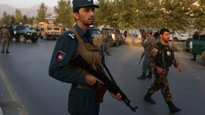Afghan security forces stand guard after an attack on the American University of Afghanistan in Kabul, Afghanistan, on Thursday.