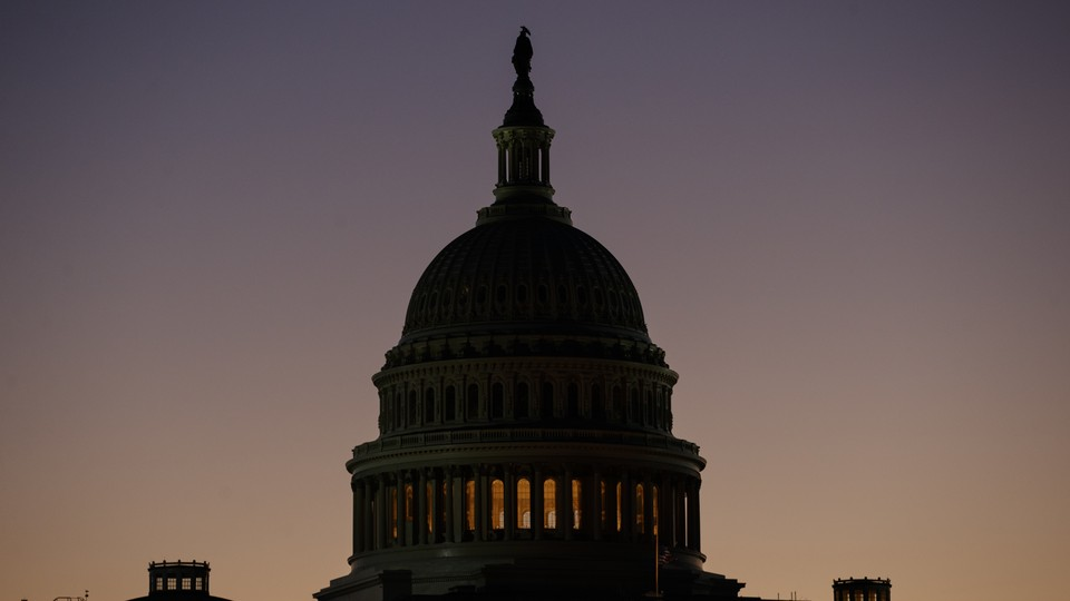 The U.S. Capitol Building dome is seen before the sun rises in Washington, D.C.