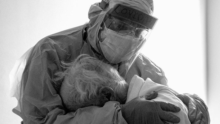 A doctor holding a patient