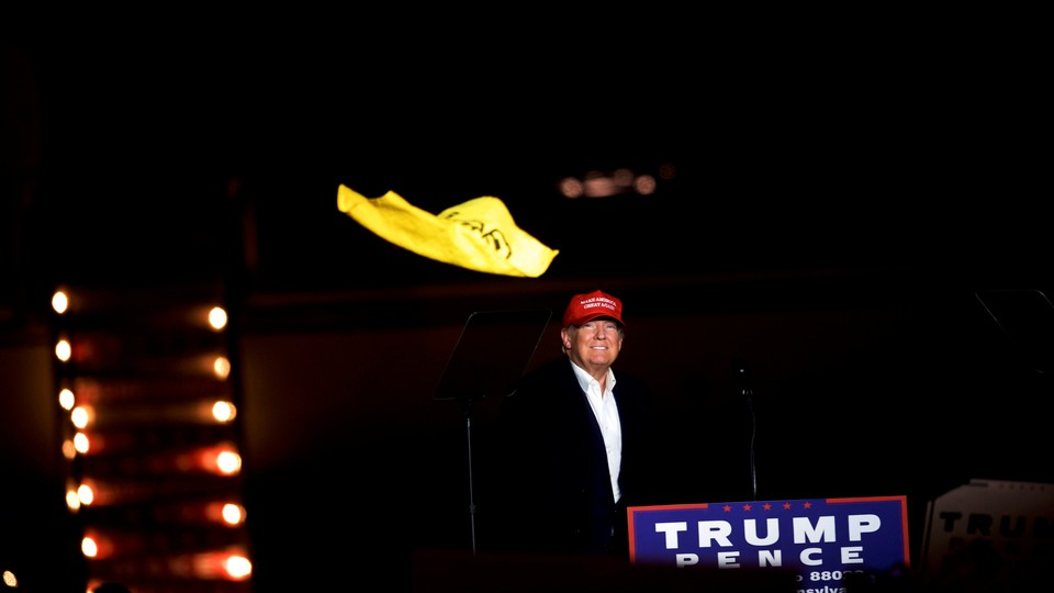 """Donald Trump throws a Pittsburgh Steelers """"Terrible Towel"""" at a rally in Pennsylvania in November 2016."""