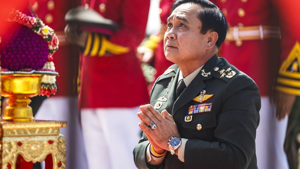 Prayuth Chan-ocha, the head of Thailand's military junta, prays at a military parade in 2014.