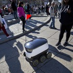 A small wheeled delivery robot on the streets of Washington, D.C.
