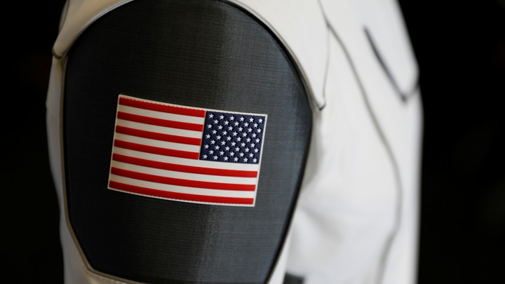 An American flag patch on the arm of SpaceX's space suit for astronauts