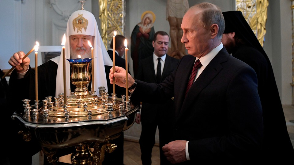 Vladimir Putin and Kirill, the patriarch of the Russian Orthodox Church, light candles at a ceremony at a monastery near Moscow in 2017.