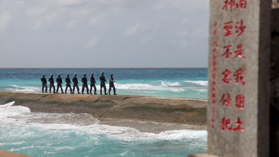 Chinese Navy sailors patrol the disputed Spratly Islands