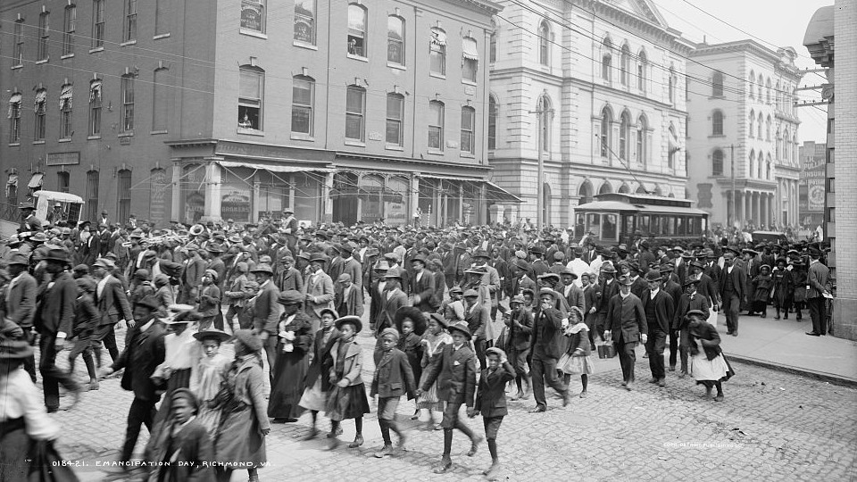 Parade of people celebrating Juneteenth in Richmond, Virginia