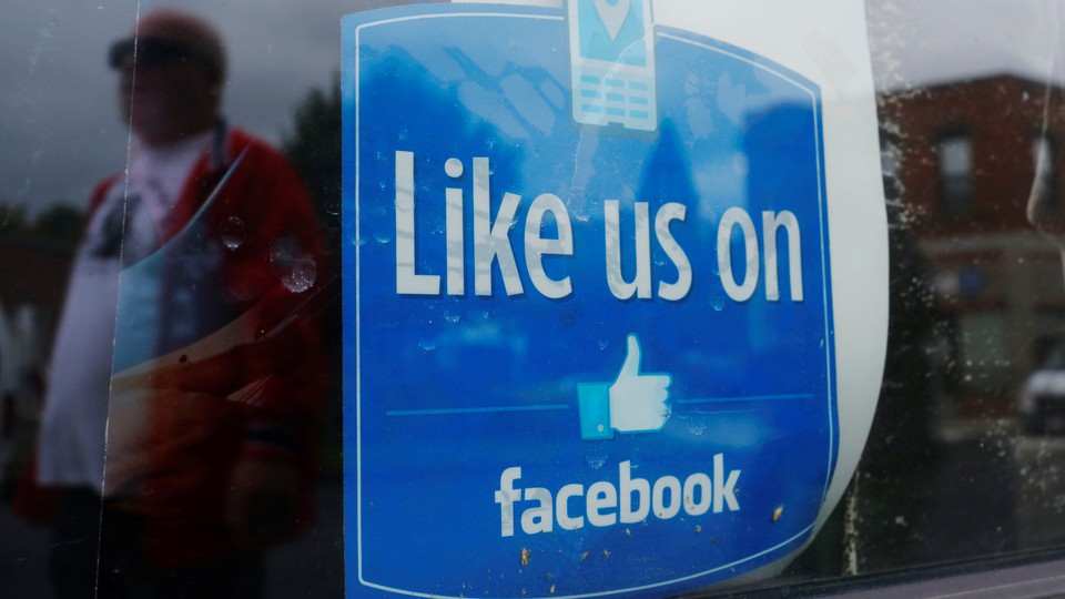 """A window advertisement that says """"Like us on Facebook"""""""