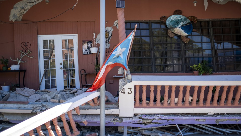 A collapsed house is seen after an earthquake hit the island in Guanica, Puerto Rico, on January 7, 2020.