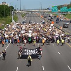 Demonstrators march on I-94 while participating in a protest against police brutality and the death of George Floyd on May 31