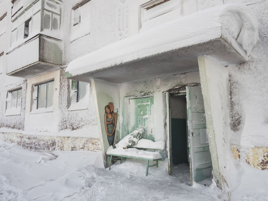 The entryway to a snow- and ice-covered building