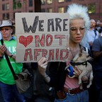 A woman holds a sign at a vigil for the victims of the Manchester attack.