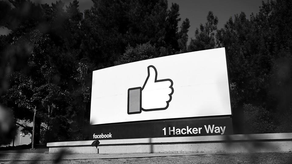 A Facebook sign reading 1 Hacker Way