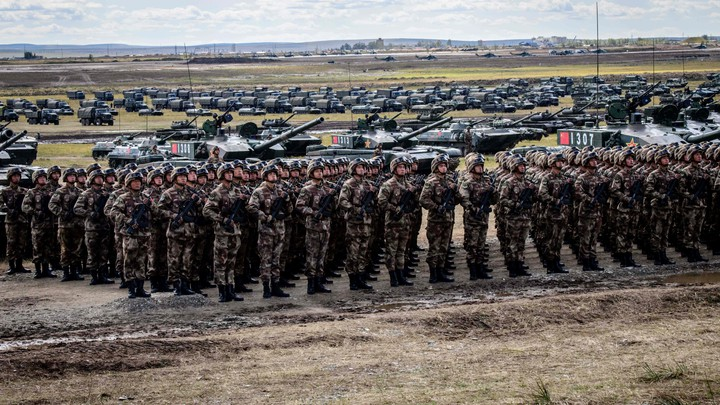 Chinese troops stand lined up in front of tanks during the Vostok-2018 exercises.