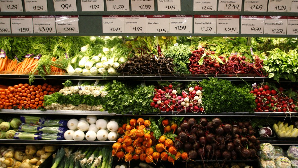 Vegetables on grocery-store produce shelves
