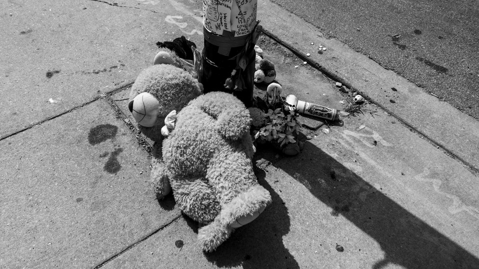 A teddy bear lies at a memorial for a shooting victim in Chicago.