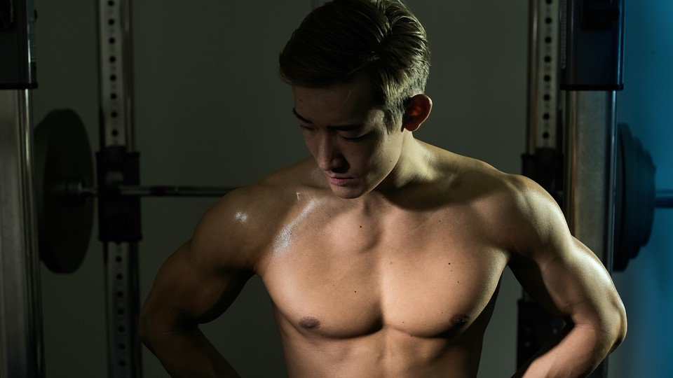 A shirtless man in a gym