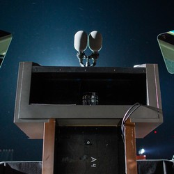 Photograph of an empty podium and teleprompter