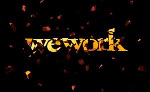 "illustration of shattered metallic-gold ""wework"""