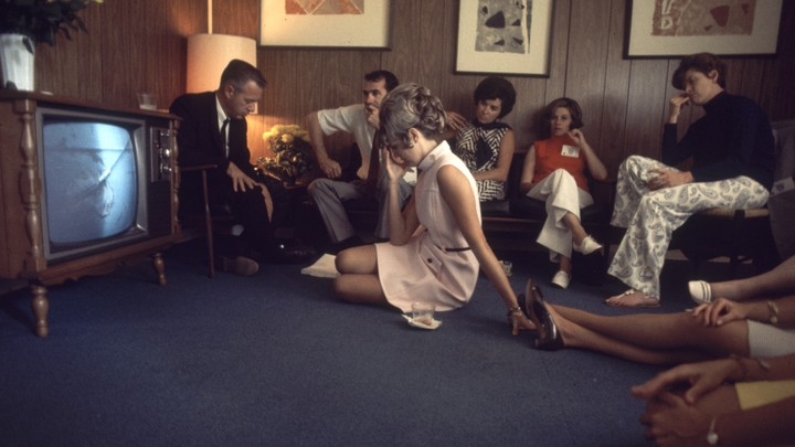 A family watches the launch of NASA's Apollo 10 mission