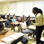 High school teacher James Ford jokes with students in his class.