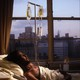Howard Bagby, PWA, lies in bed at the VA Hospital in New York City, 1987