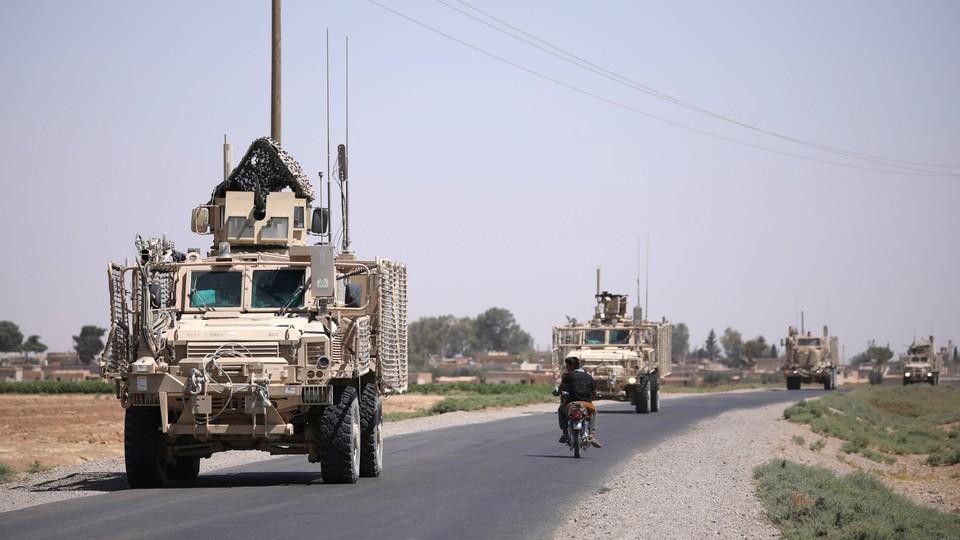 A U.S. military convoy in Raqqa, Syria