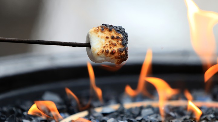 A marshmallow roasting over a fire
