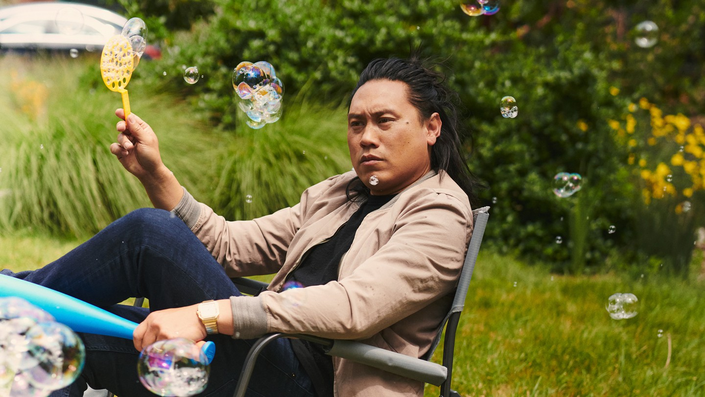 Jon Chu in a yard chair with bubbles