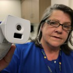 Registered nurse Tara McCormick demonstrates an infrared thermometer at West Virginia University Hospital in Morgantown, West Virginia on September 6, 2017.