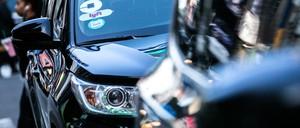 photo: Uber and Lyft vehicles.