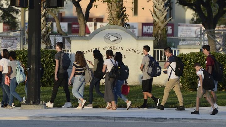 Students from Marjory Stoneman Douglas High School return for a new school year after summer recess on August 15, 2018.