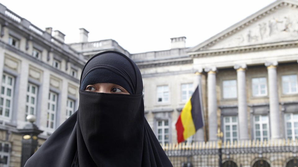 A woman wearing the niqab is pictured outside the Belgian Parliament in Brussels on April 26, 2010.