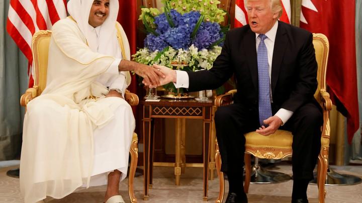 Qatar's Emir Sheikh Tamim Bin Hamad Al-Thani meets with U.S. President Donald Trump in Riyadh