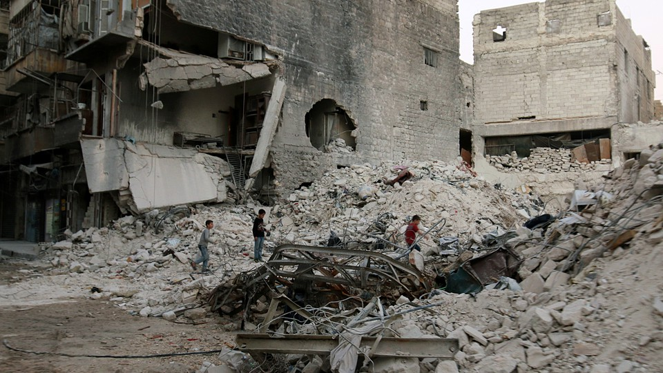 Boys climb over rubble