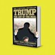 The cover of Donald Trump's 'The Art of the Deal' with a cutout of Trump raising his fists